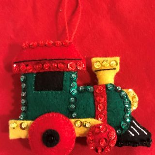 Beautifully handcrafted felt & sequin ornament.  Made locally.